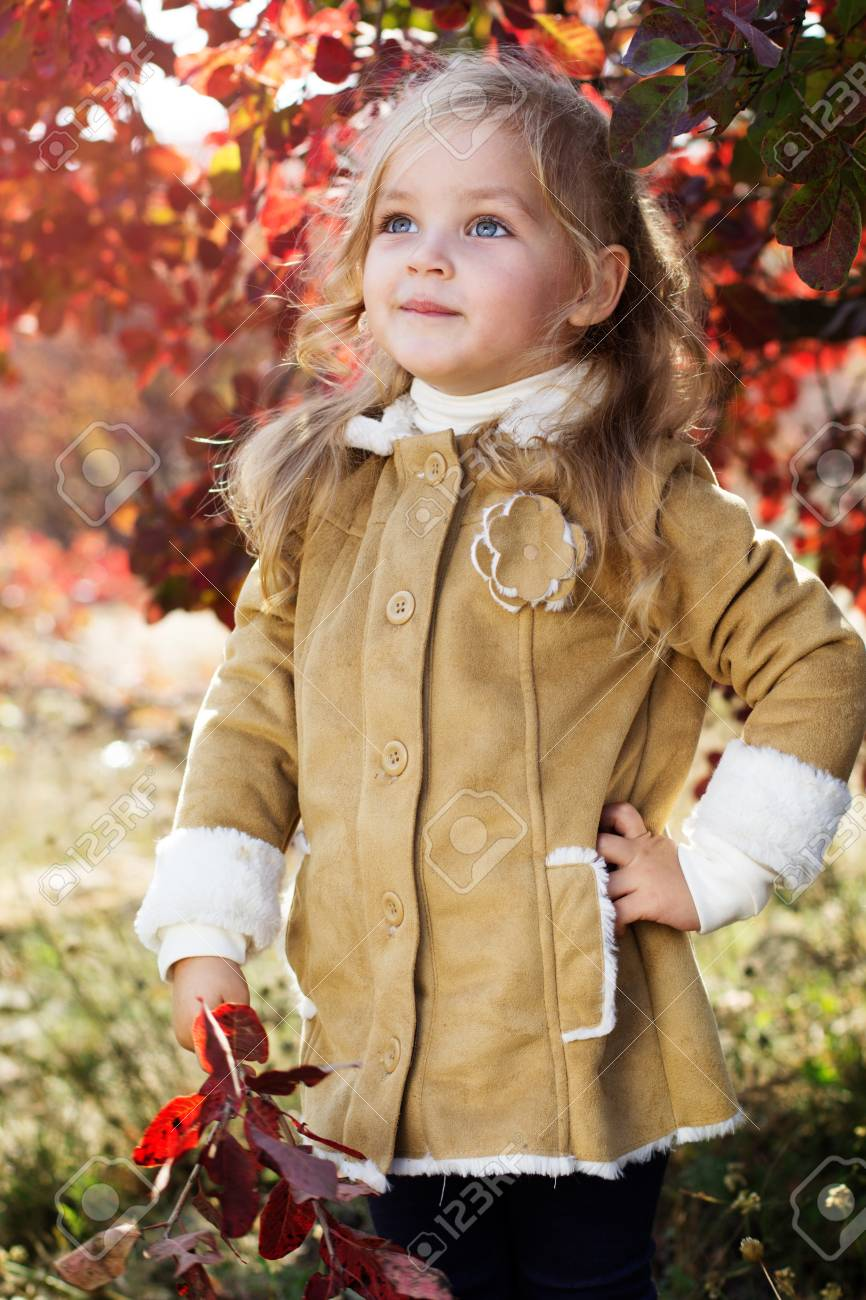 c3fa0eb1d644 Adorable Little Girl Is Wearing Winter Clothes Stock Photo