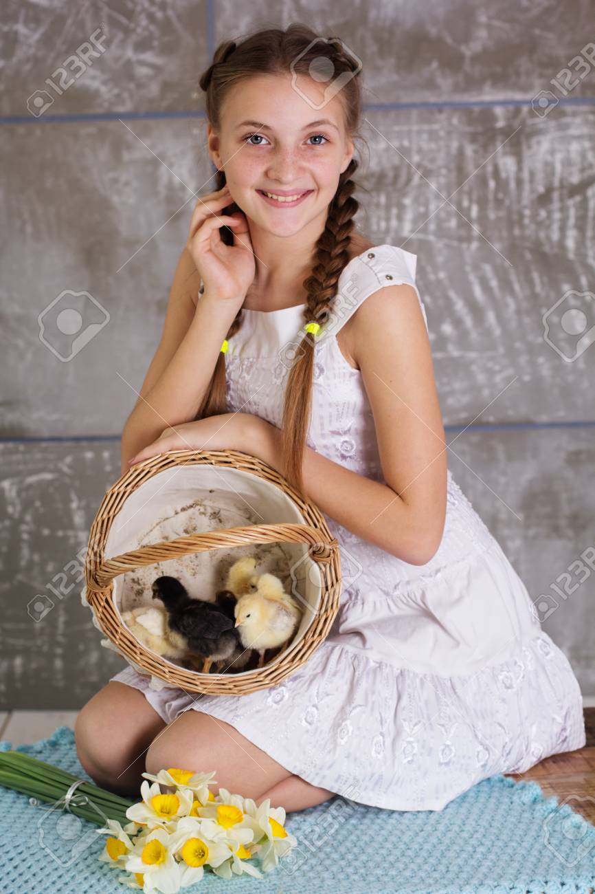happy teen girl with yellow small chicks in basket stock photo 61878352 - Small Teen Pics