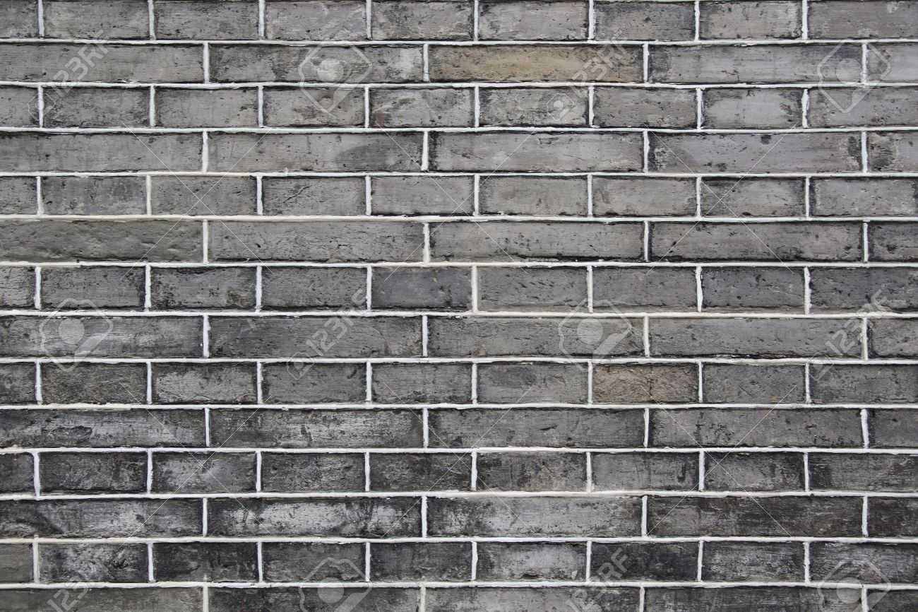 Black Brick Wall abstract background of the vintage black brick wall stock photo