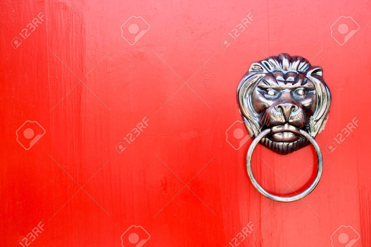 lion knocker on the chinese traditional red door Stock Photo - 9777067
