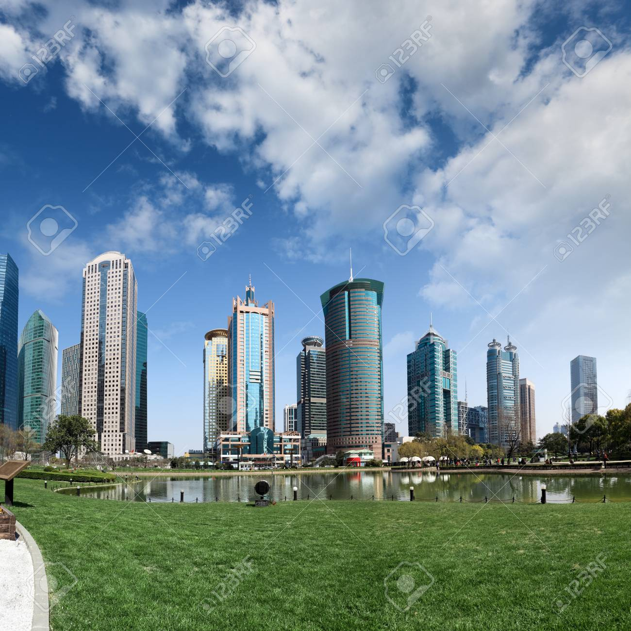 park and skyscrapers under the blue sky in shanghai Stock Photo - 13066759