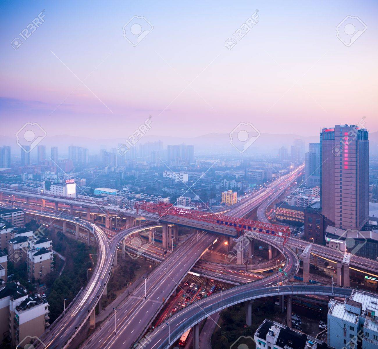 cloverleaf interchange at dusk,urban traffic concept Stock Photo - 13775948