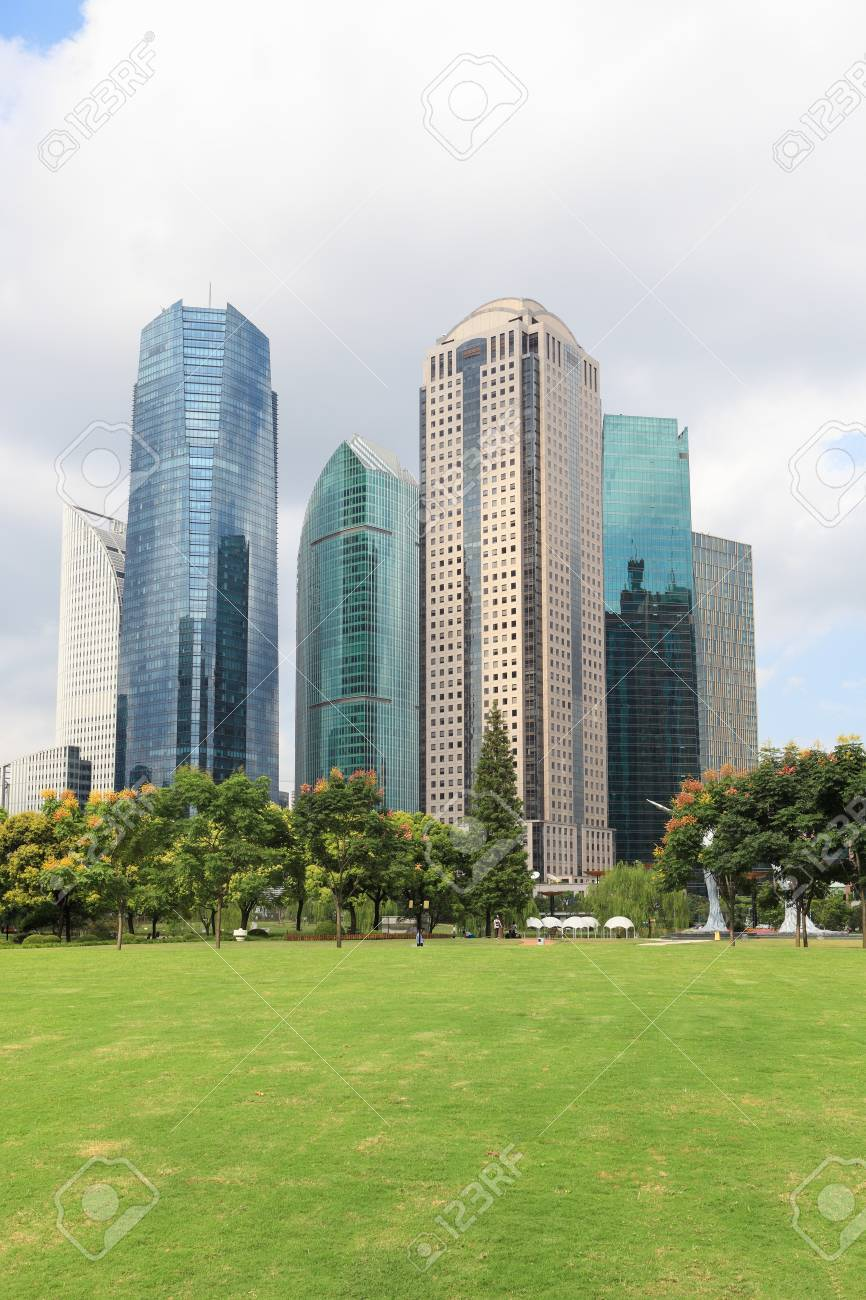 lawn with modern city in shanghai Stock Photo - 16272546