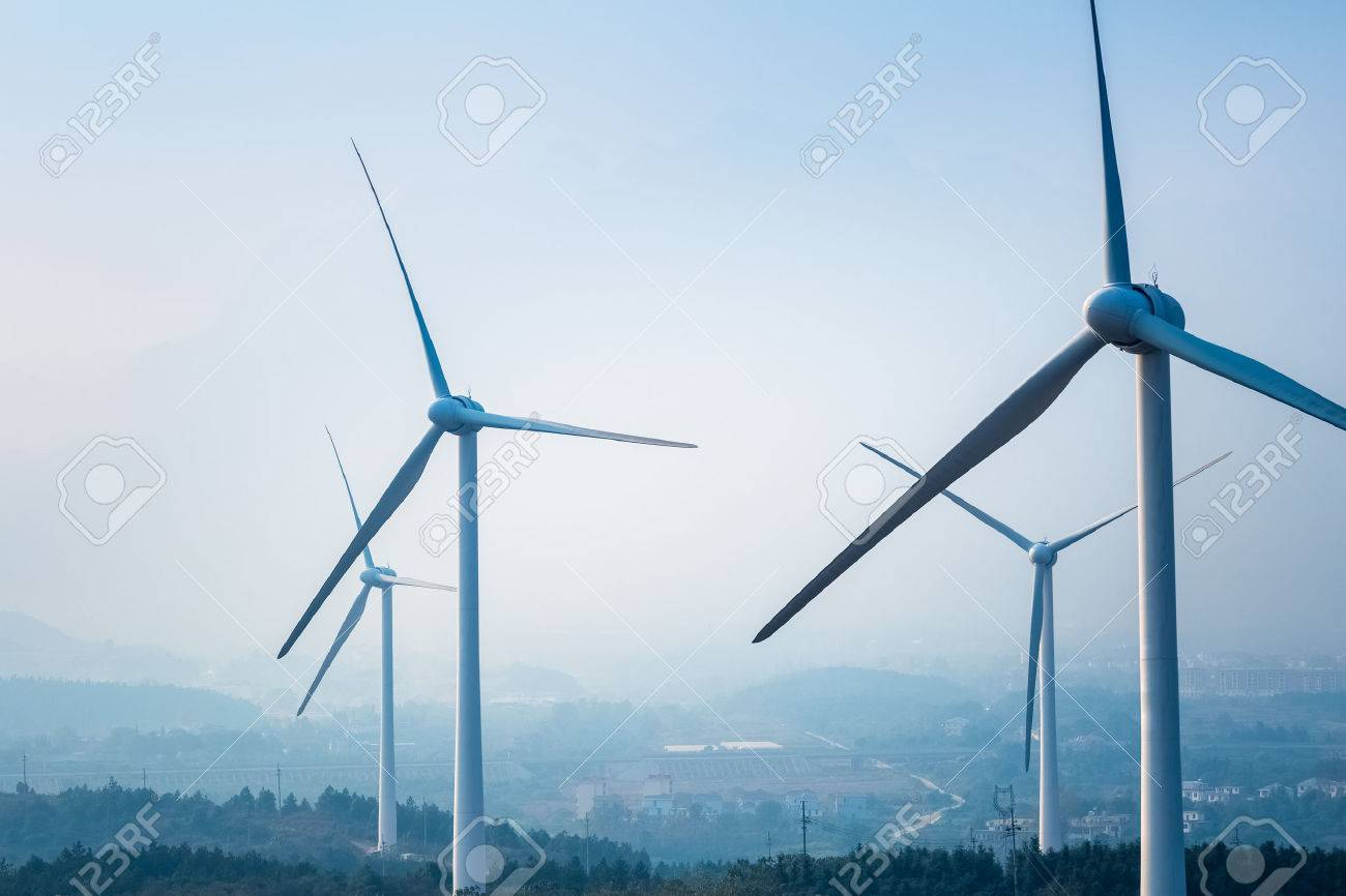 wind farm closeup ,new energy with fog and haze weather - 32905442