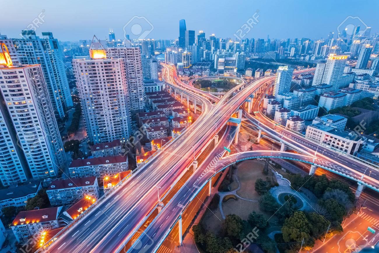 city interchange at nightfall in shanghai, modern transport infrastructure background - 38465398