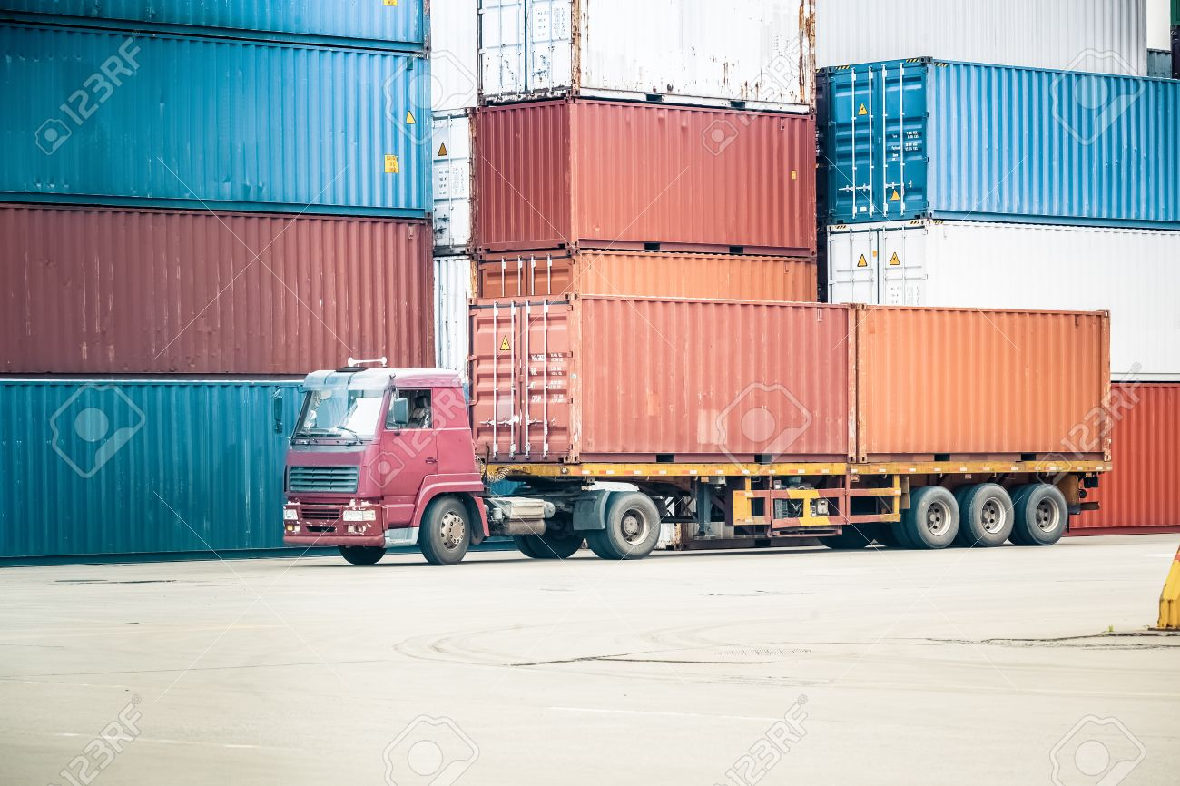 The Cargo Containers Truck In Storage Area Of Freight Port Terminal