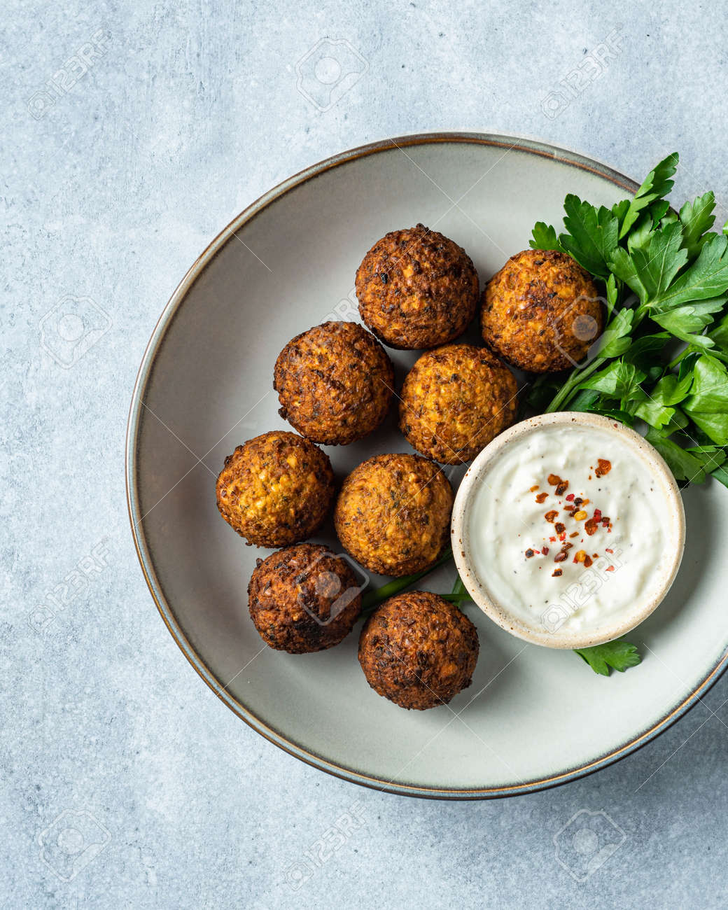 falafel with sauce on a blue background, view from above, selective focus - 169788423