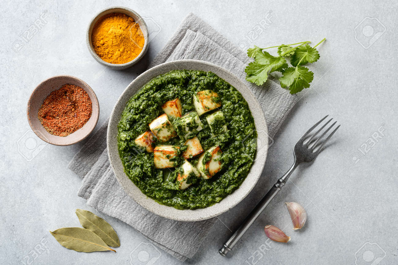 Palak Paneer indian traditional food on concrete background, top view - 167342084