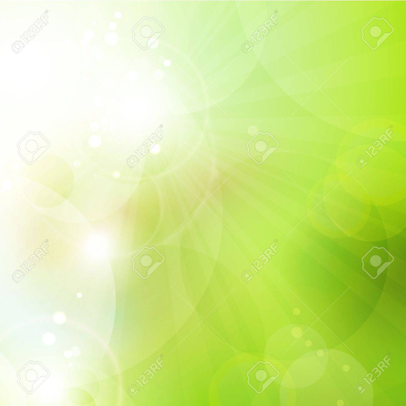 Abstract green blurry background with overlying semitransparent circles, light effects and sun burst Great spring or green environmental background Space for your text - 17133658