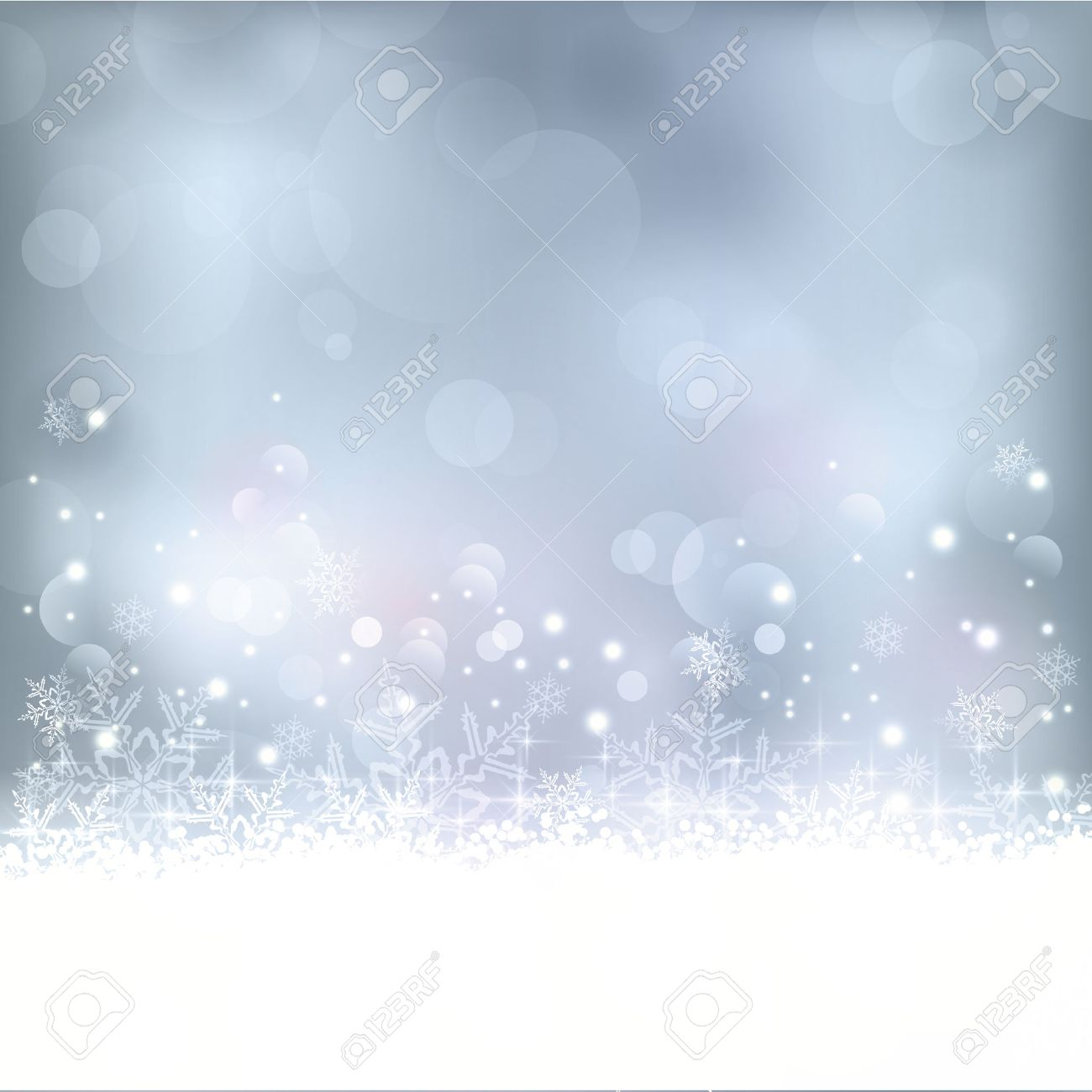Wintry blue abstract background with out of focus light dots, stars,snowflakes and copy space. Great for the festive season of Christmas to come or any other winter occasion. - 32779968