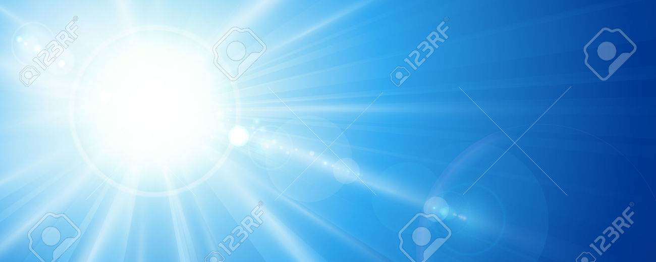 Sun rays and lens flare in a bright blue sky in horizontal, panorama format. Space for your text. - 51013485