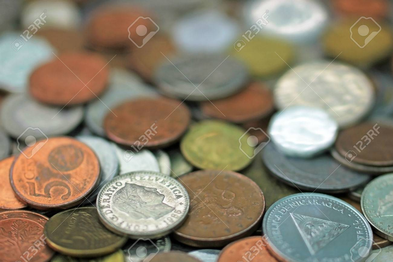 Mixed World Currency Coins Swiss Franc And Cordoba Oro Nicaragua Stock Photo Picture And Royalty Free Image Image 82968532