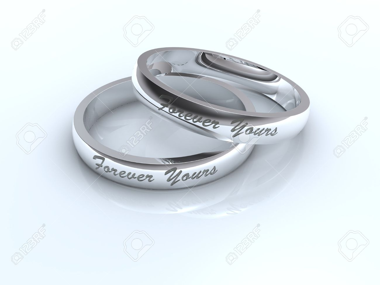 Silver Wedding Rings With Forever Yours Inscription Stock Photo