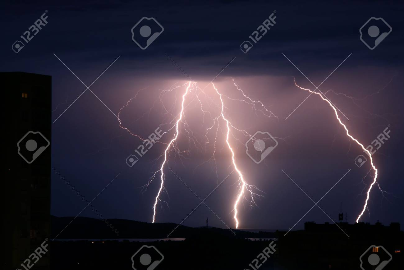 Lightning storm strikes over city and sea Stock Photo - 7002455