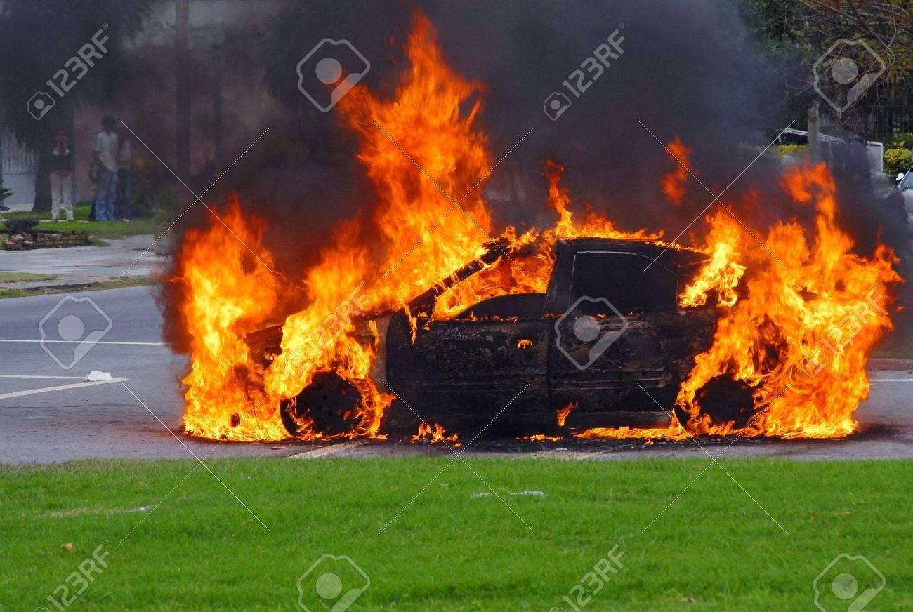 Fire burning car at street corner. Montevideo, Uruguay. Stock Photo - 5358707