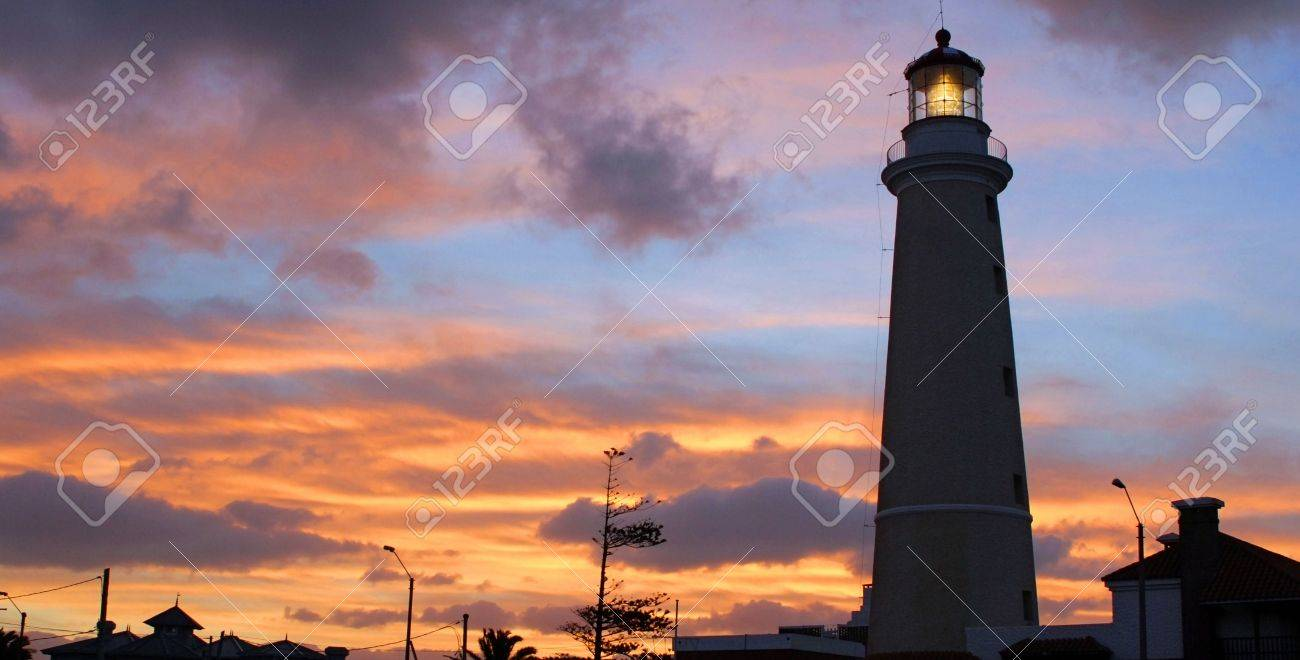 Landscape of lighthouse and roofs silhouettes. Punta del Este. Uruguay Stock Photo - 5358734