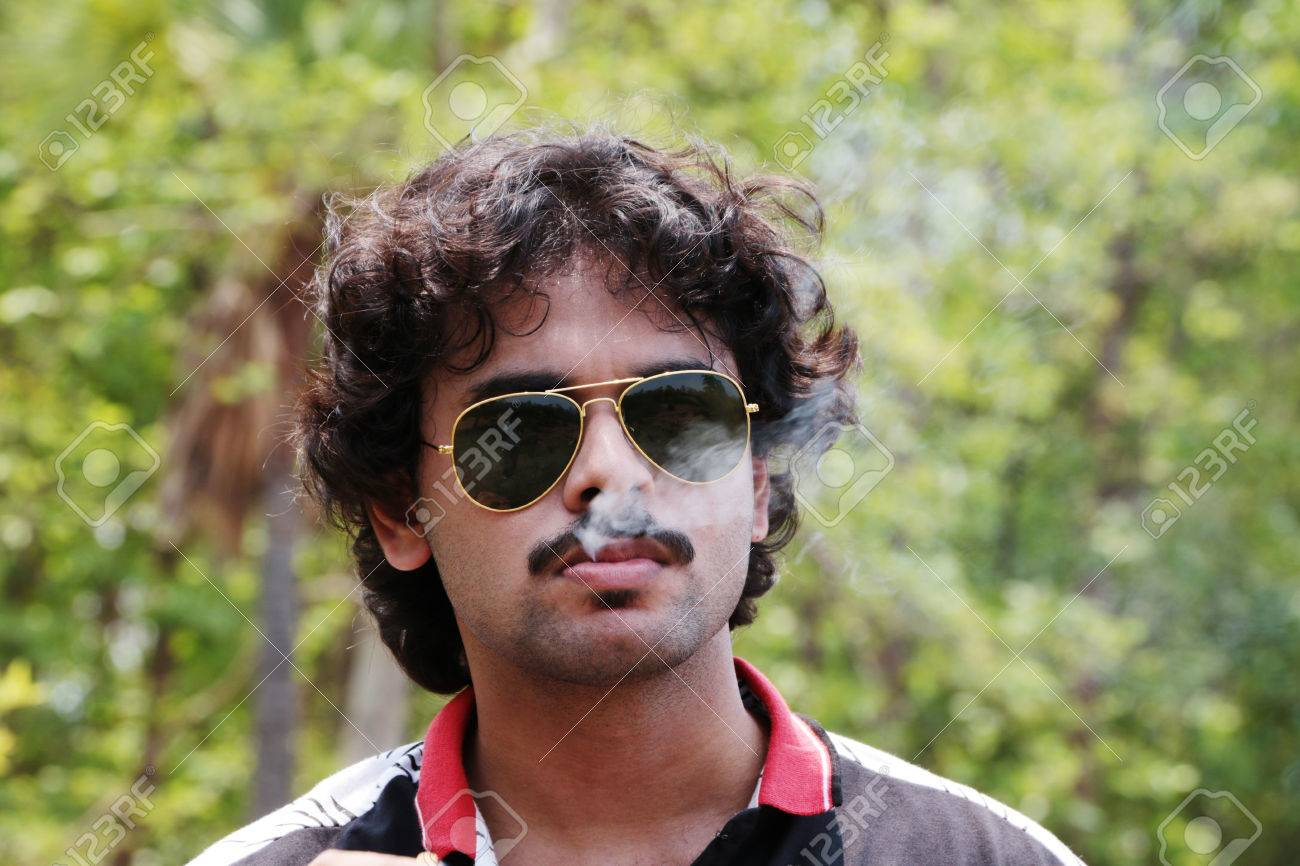 Bengali Handsome Young Boy With Mustache Wearing Sunglass Smoking Cigarette Stock Photo