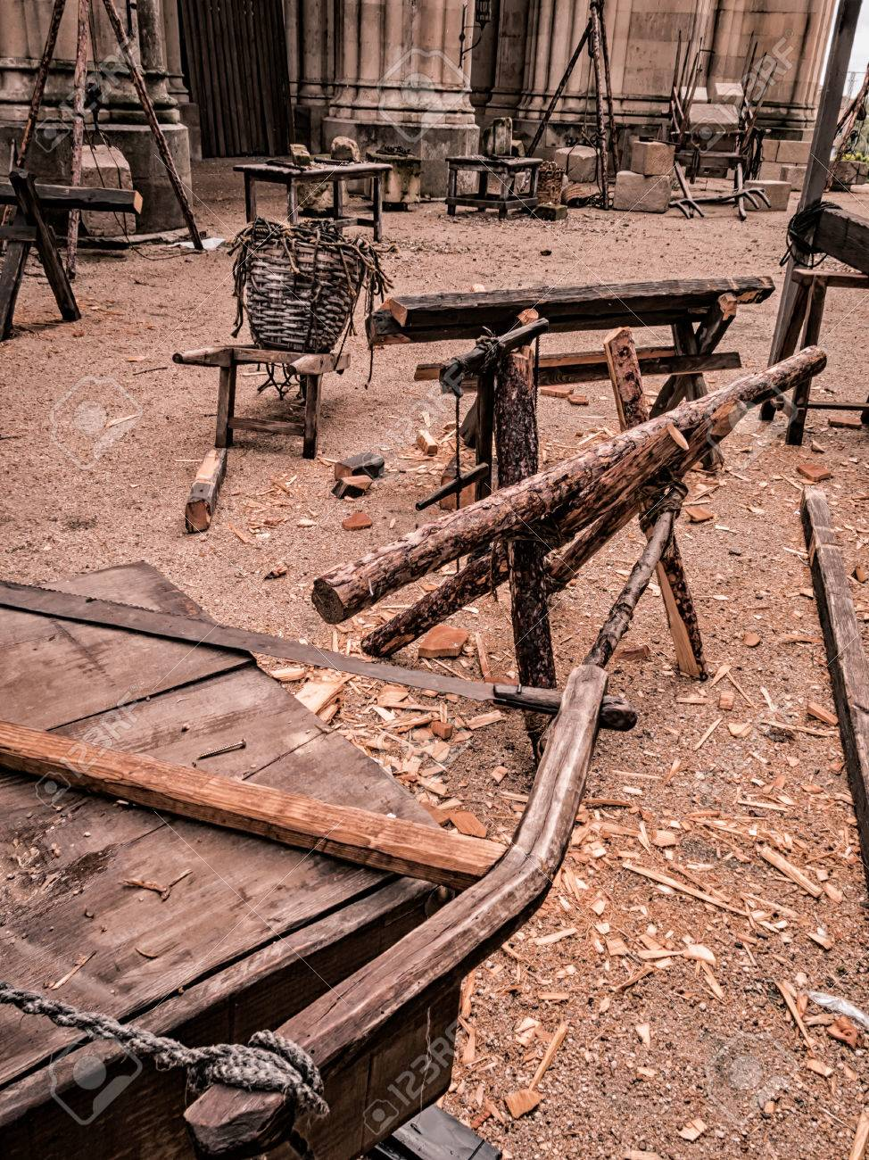 Old tools of a artisan sawmill : saw, ropes, wood