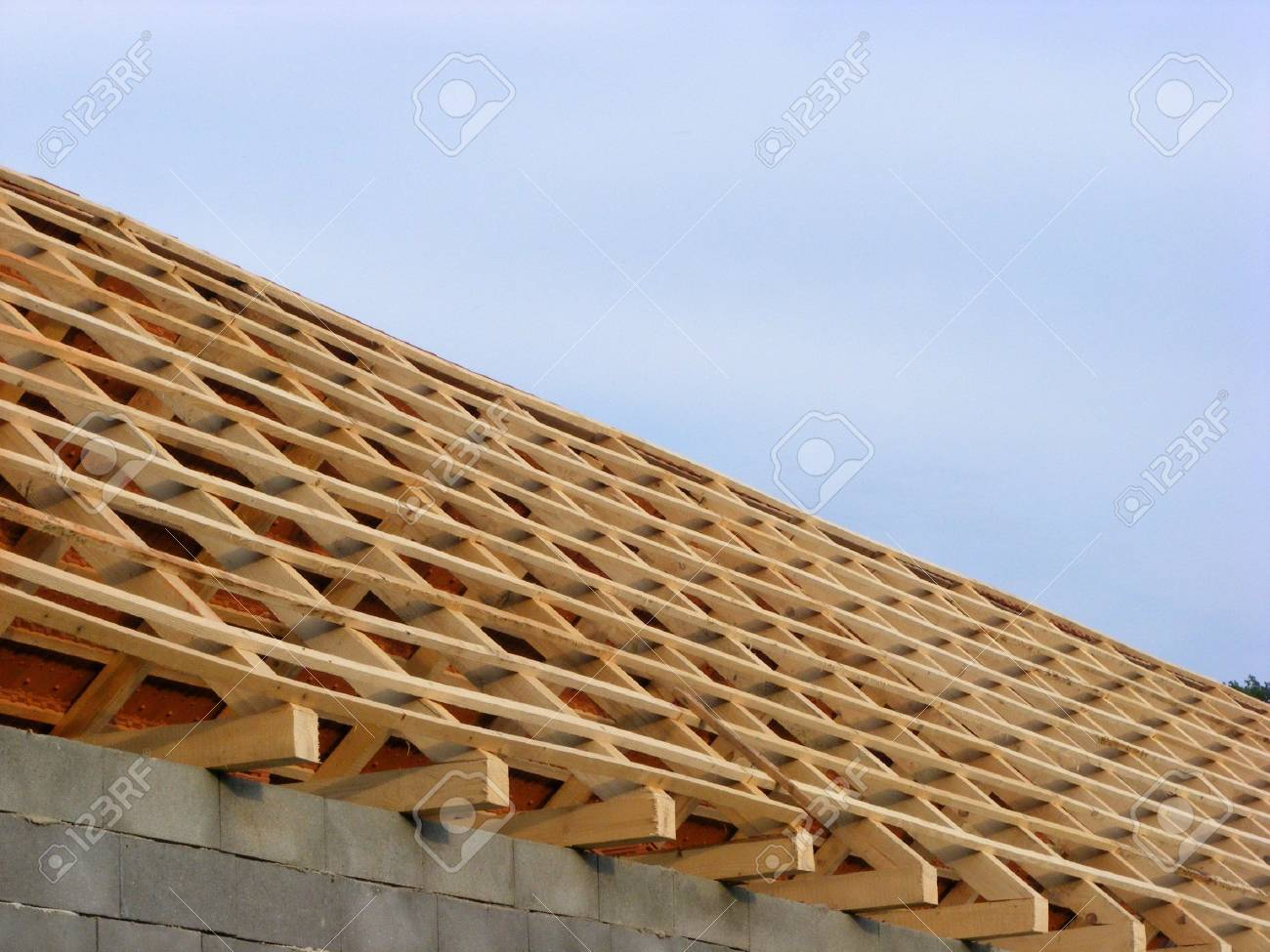 Old House Construction Roof With Tiles And Wooden Planks In The