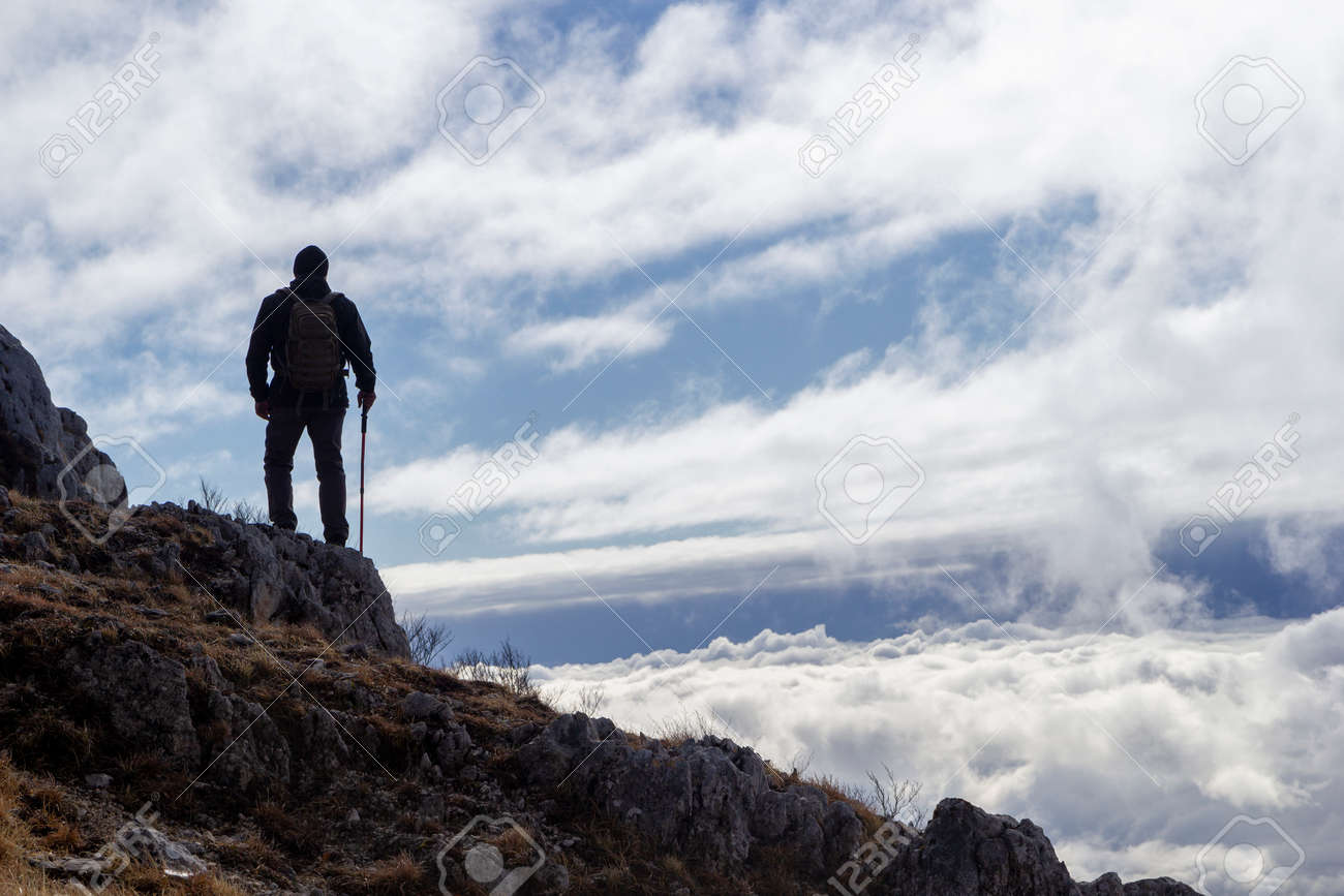 hiker on the top of a mountain - 146768983