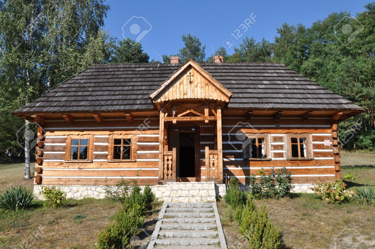 Little Wooden Cottage In The Woods Stock Photo