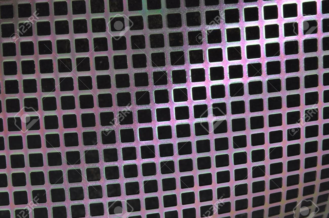 Metal surface with holes in the shape of squares Stock Photo - 16389374