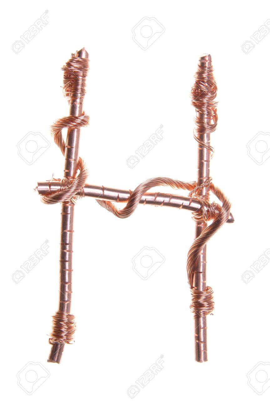 Twisted Copper Wire In The Shape Of The Letter H Stock Photo ...