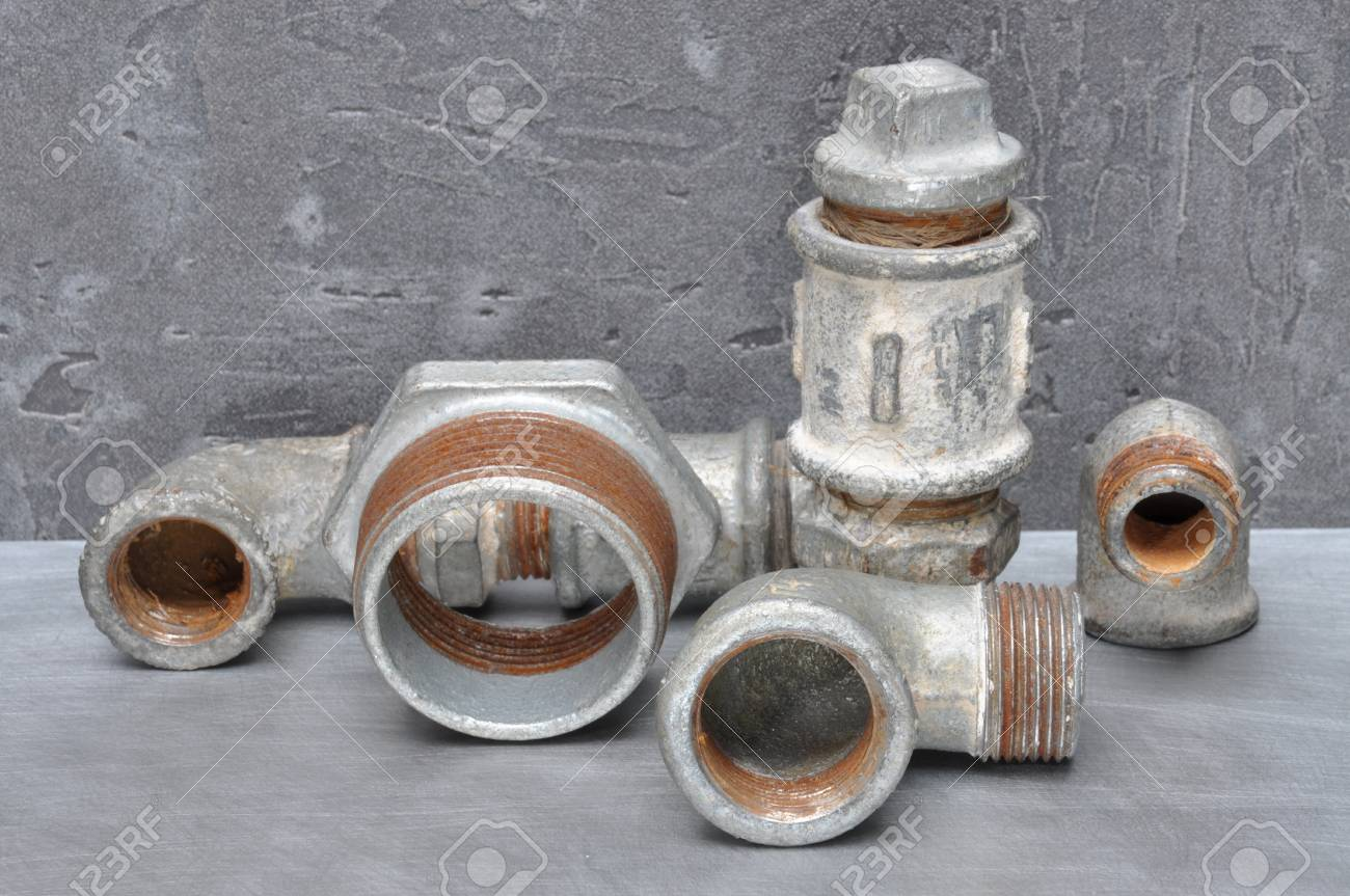 Old Plumbing Parts On Gray Metal Board Stock Photo, Picture And ...