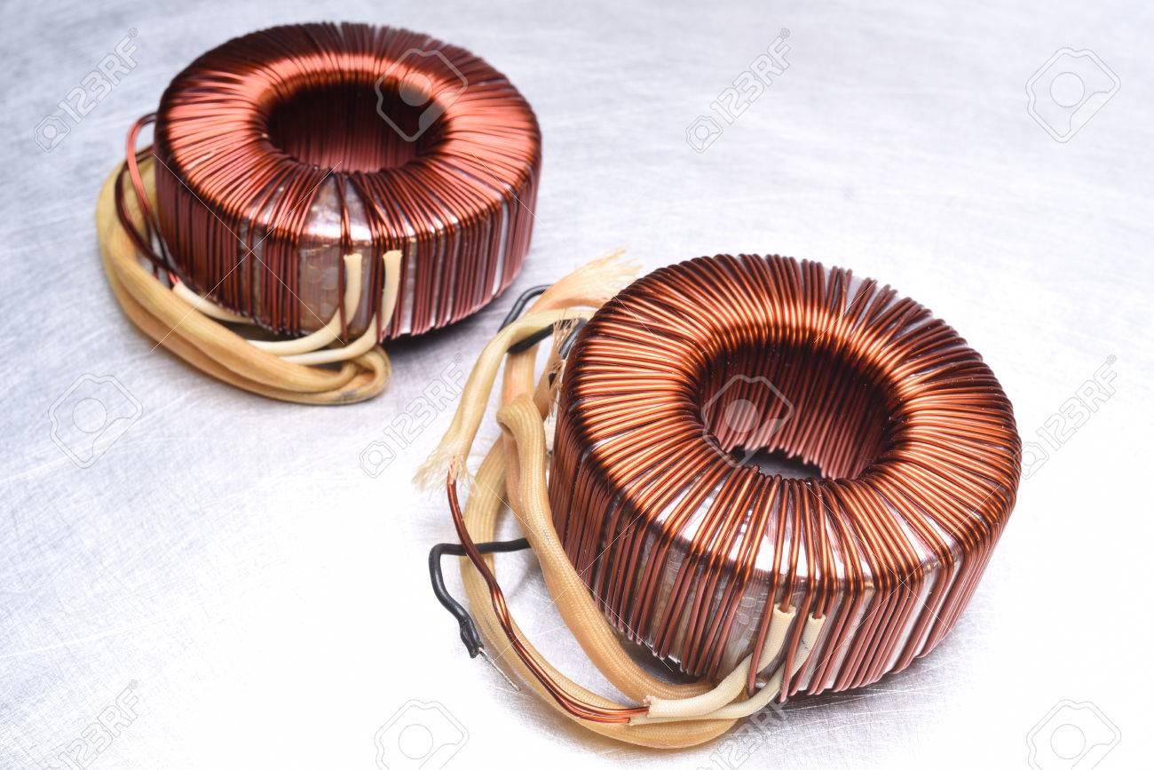 Copper Coils Transformer on Metal Background