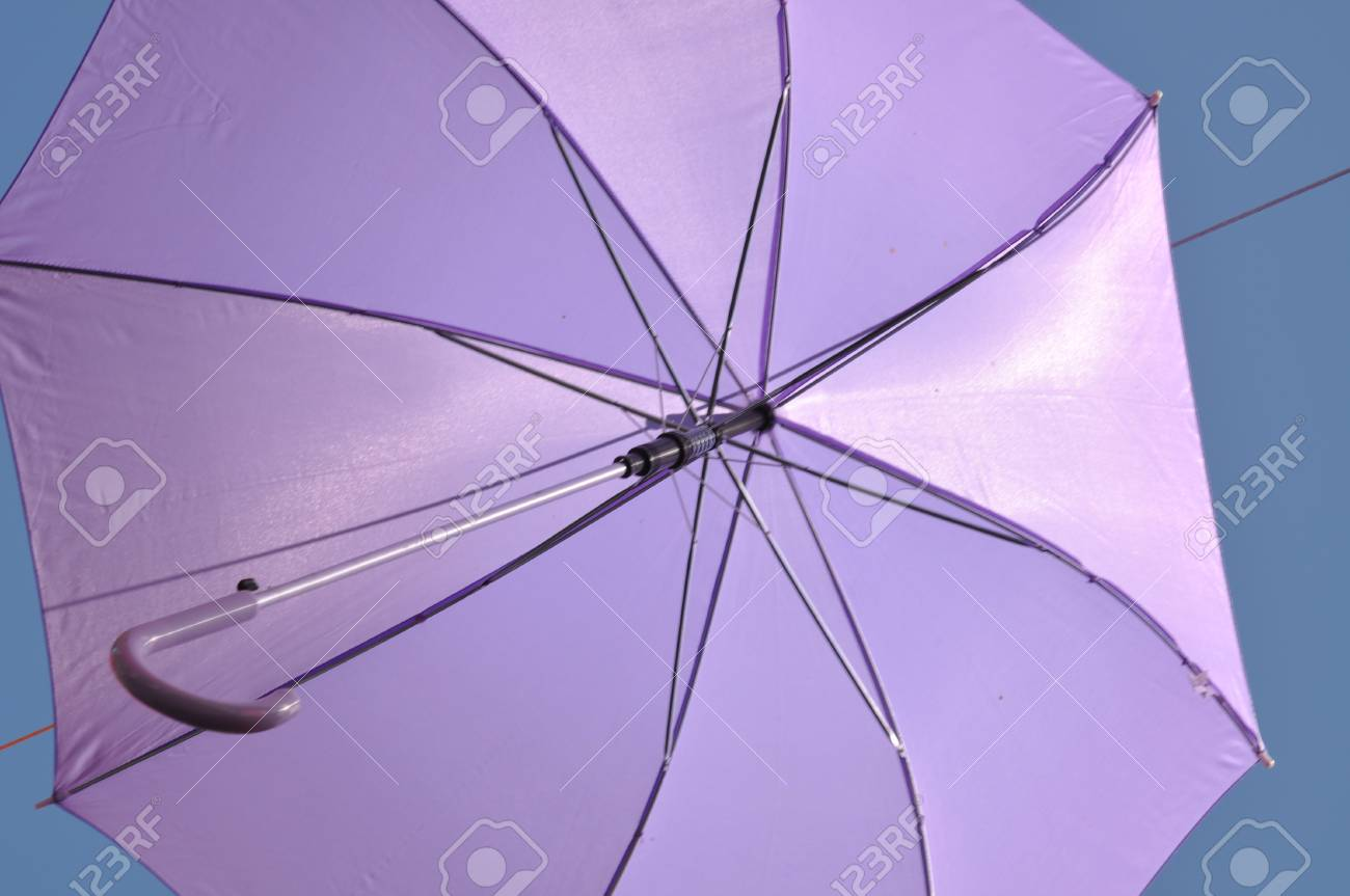 Stock P O Ed Umbrella Against Blue Sky View From Below
