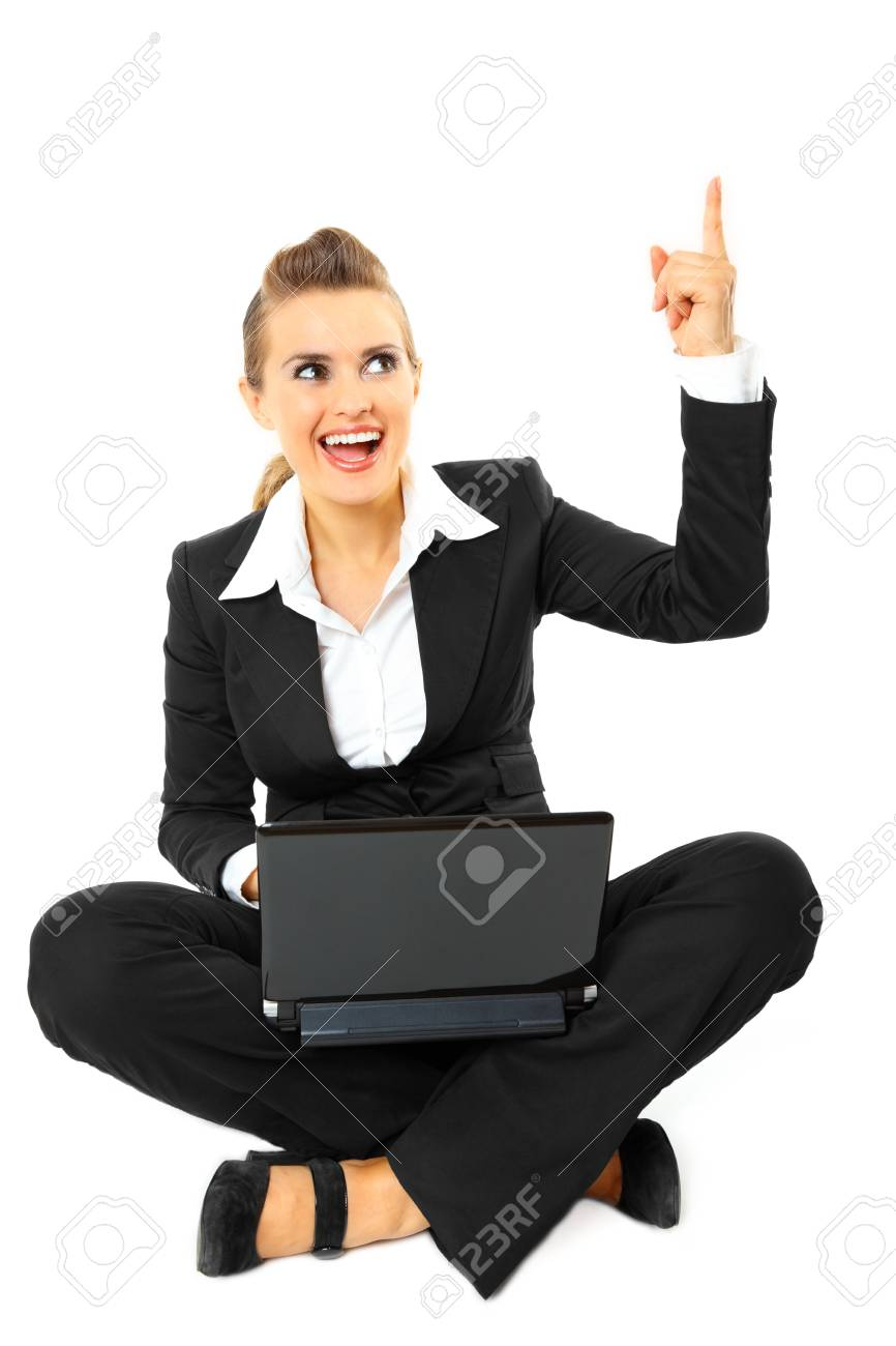 Smiling modern business woman got  idea while sitting on floor with  laptop  isolated on white Stock Photo - 8343874