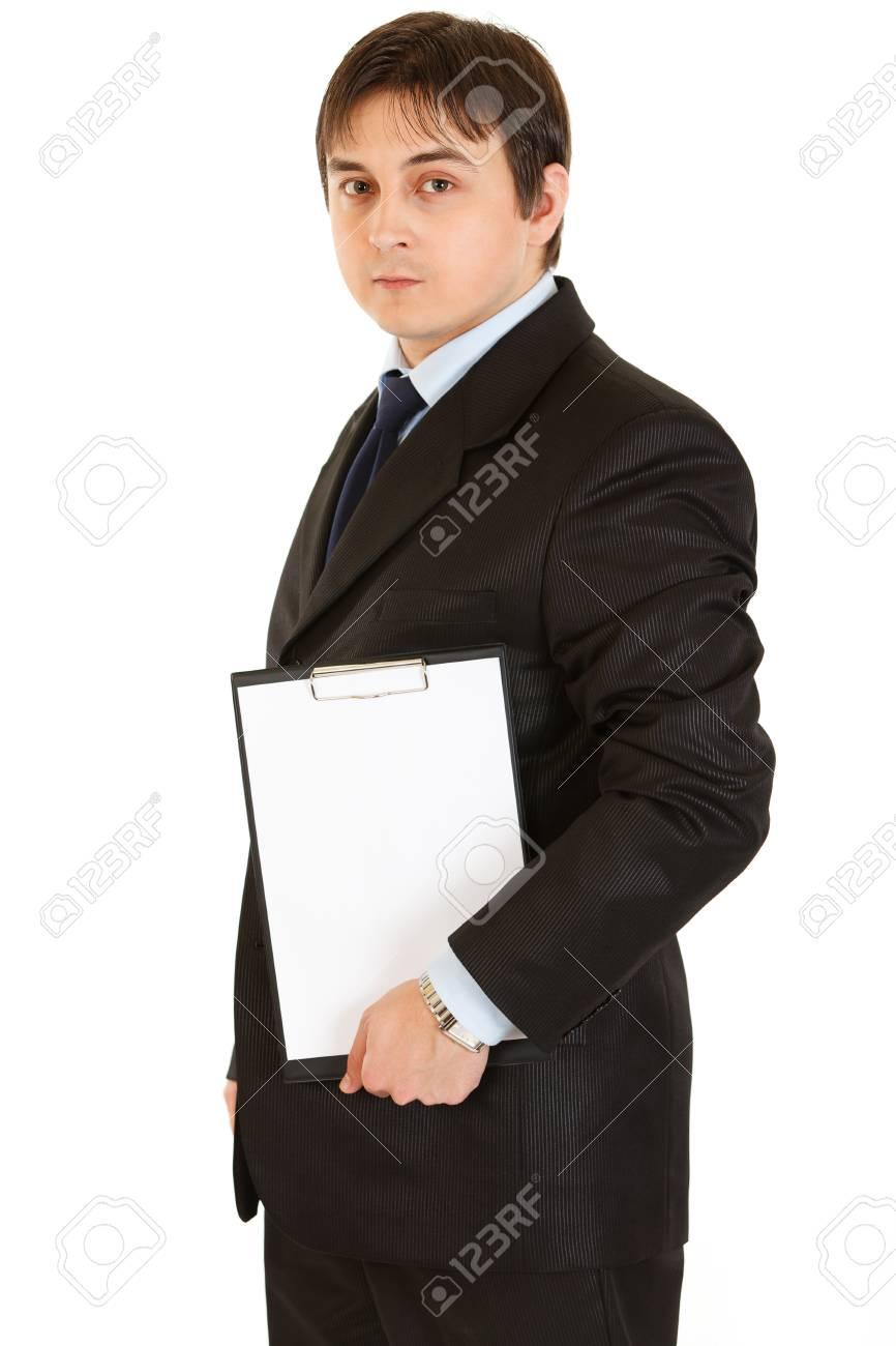 Pensive modern businessman holding blank clipboard Stock Photo - 8845986