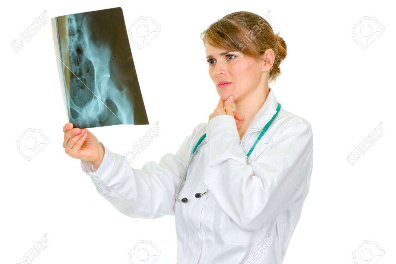Concentrated medical female doctor analyzing patients roentgen isolated on white Stock Photo - 9245215