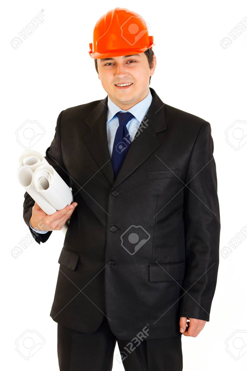 Smiling businessman in helmet holding building plans in hand isolated on white Stock Photo - 9515521