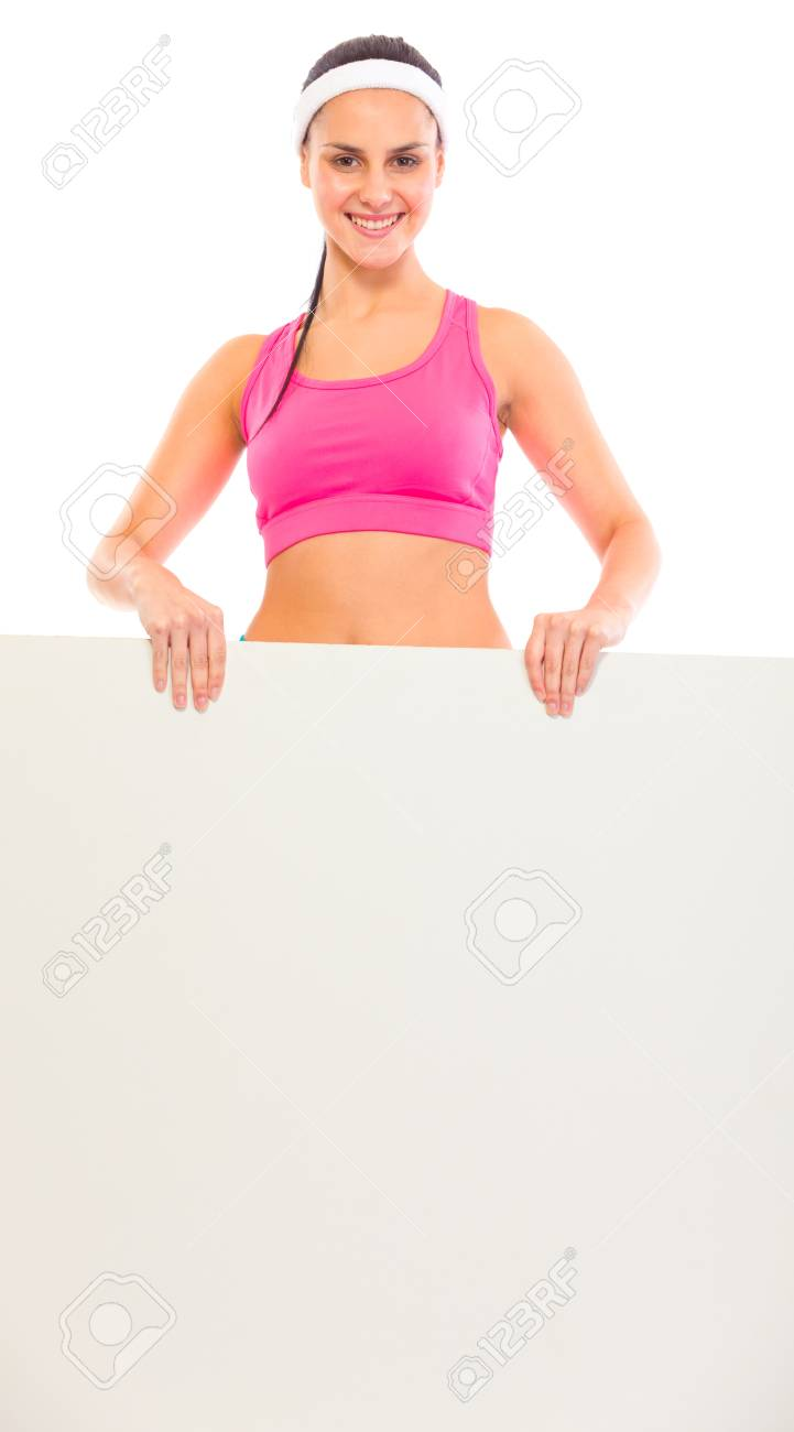 Smiling young fit girl holding blank billboard in hands isolated on white Stock Photo - 9617211