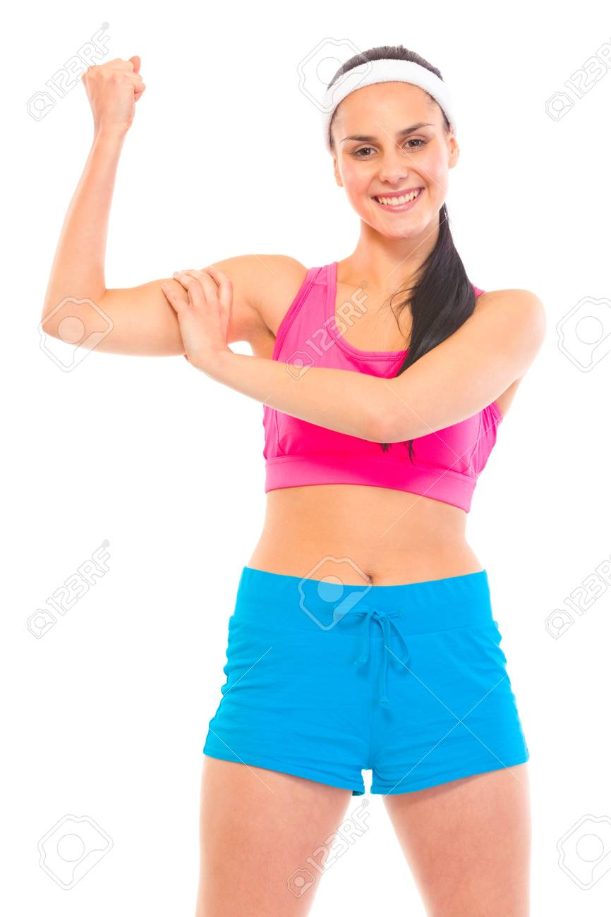 Cheerful fitness young girl in sportswear showing her muscles isolated on white Stock Photo - 9617196