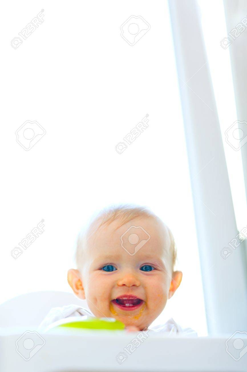 Eat smeared smiling baby girl Stock Photo - 10716337