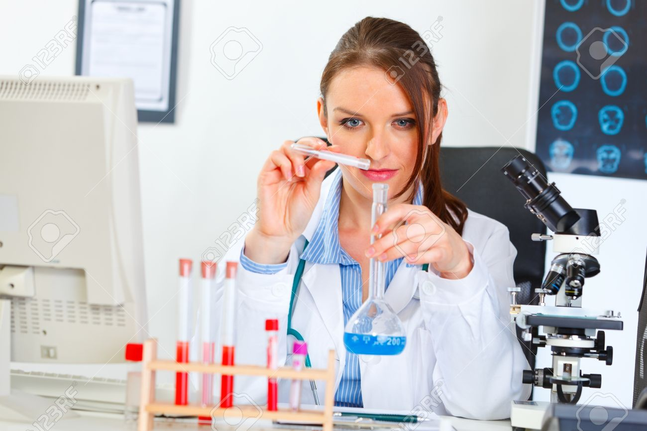Doctor woman working with test tube in laboratory Stock Photo - 11383494