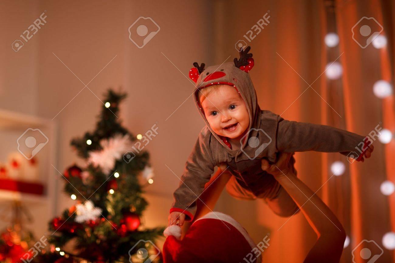 Adorable baby having fun near Christmas tree Stock Photo - 11383500