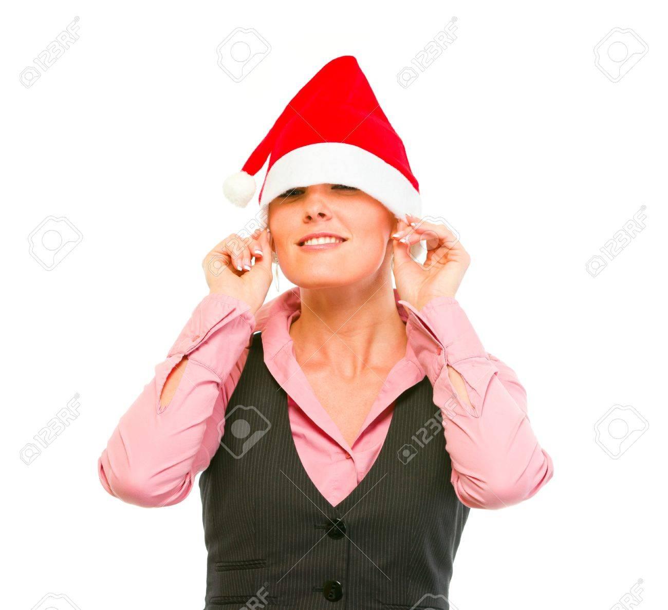 Smiling female business secretary pulling Santa Hat on eyes Stock Photo - 11640545