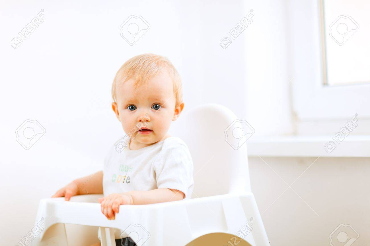 Lovely baby sitting in baby chair Stock Photo - 11640591