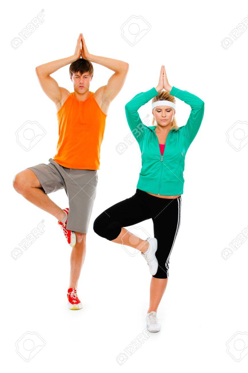Fitness girl and man in sportswear doing yoga isolated on white Stock Photo - 11825501