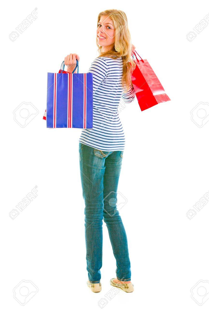 Smiling teen girl with shopping bags looking back Stock Photo - 12009407