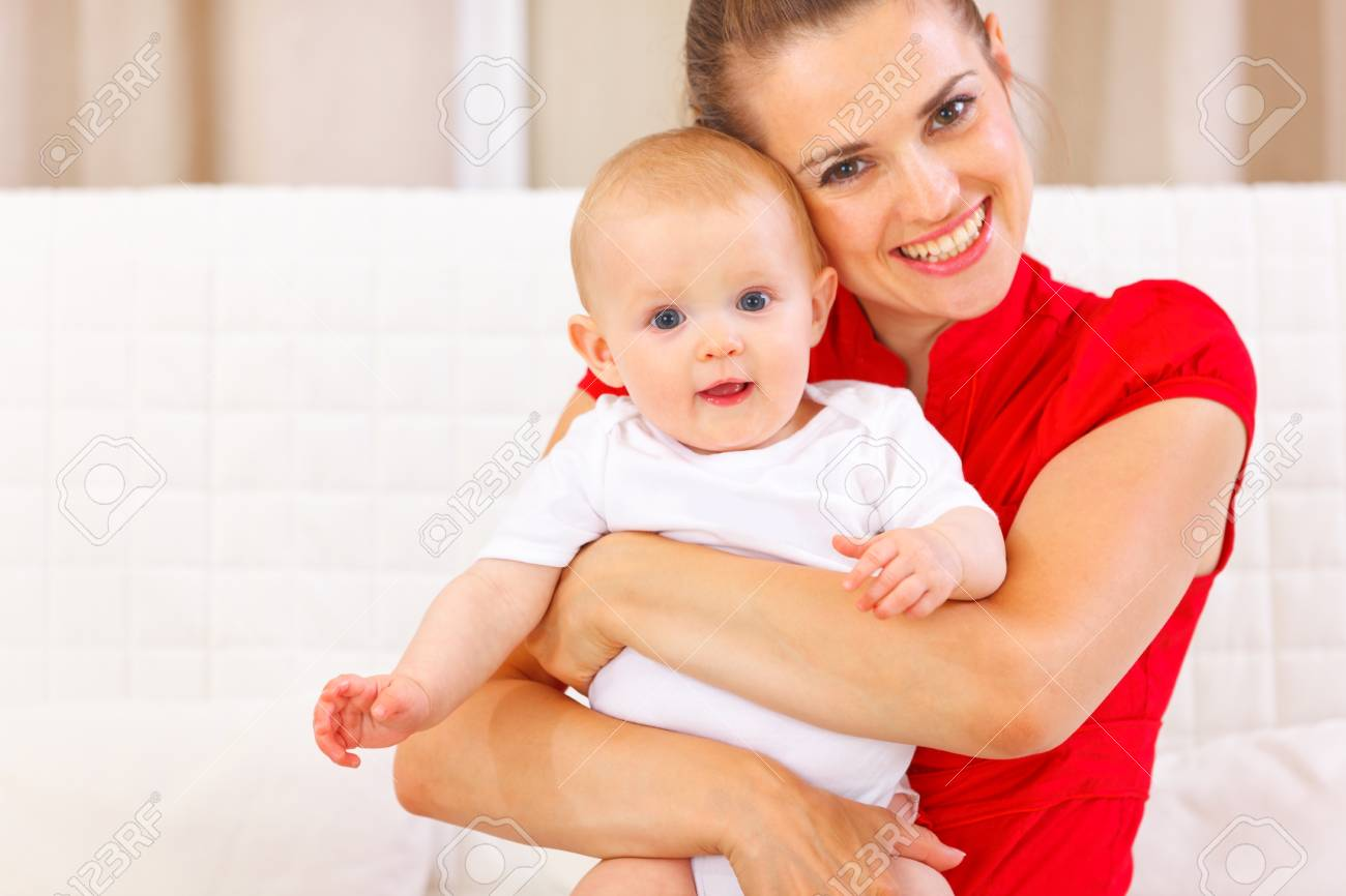 Portrait of cute baby and happy young mother Stock Photo - 12115048