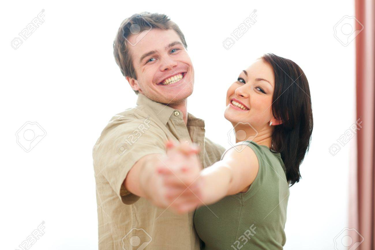 Smiling young couple dancing at home Stock Photo - 12354645