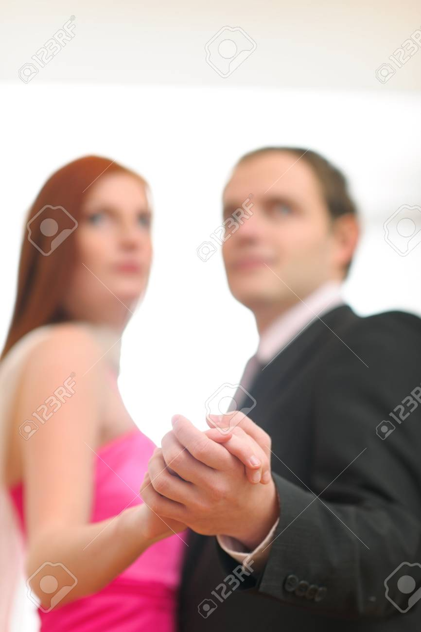 Closeup on hands of formally dressed dancing couple Stock Photo - 12354564