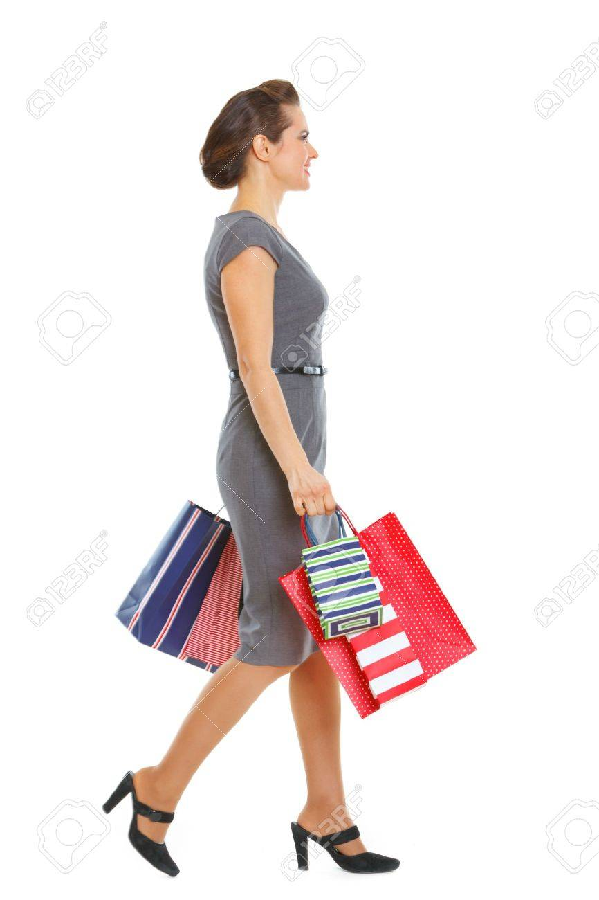 Woman in dress walking with shopping bags Stock Photo - 12354339