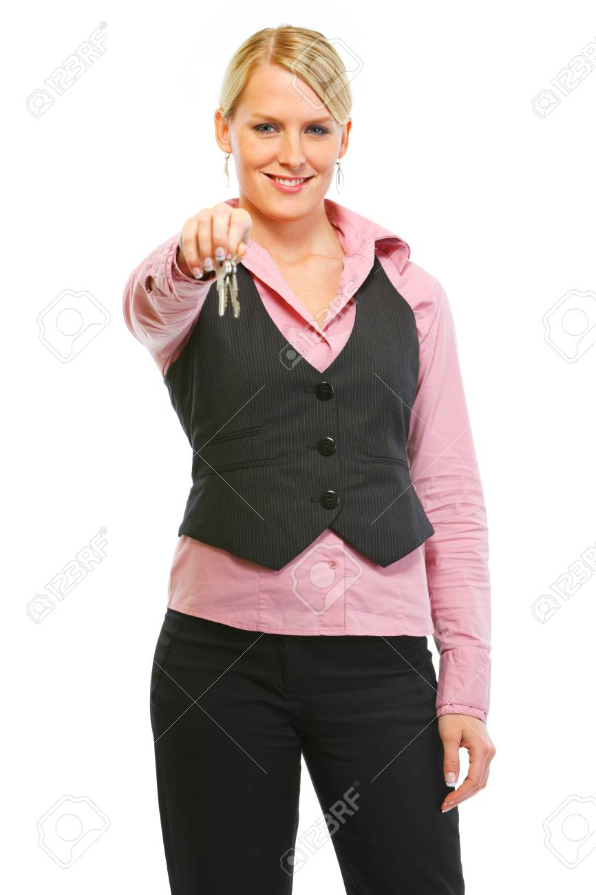 Happy real estate agent giving keys Stock Photo - 12637361