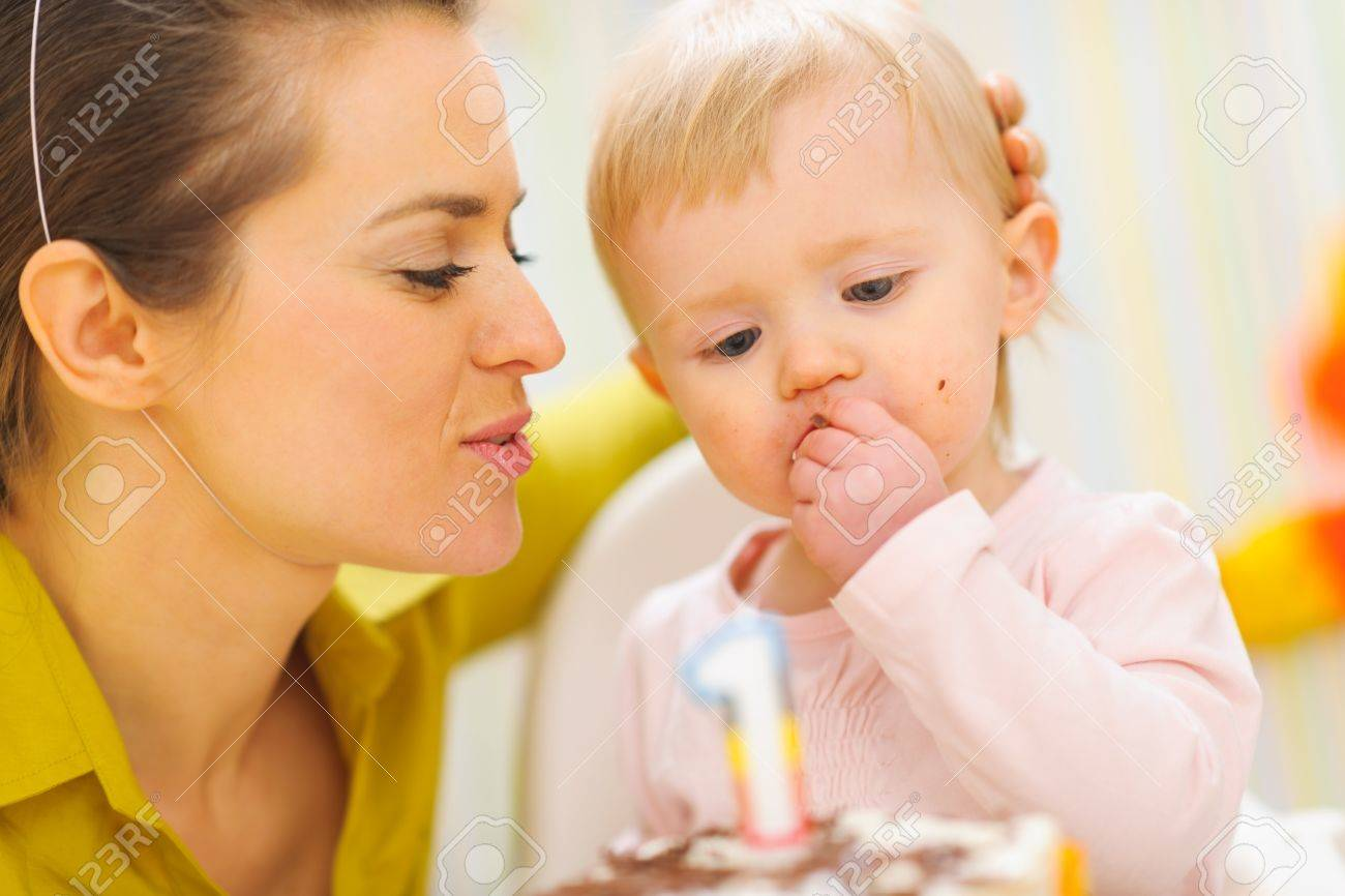 Mother congratulating eating first birthday cake baby Stock Photo - 12637448