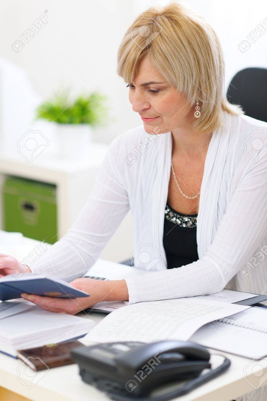 Old business woman working at office Stock Photo - 12637777